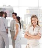 Business woman with associates smiling Stock Photos