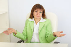 Business woman with astonishment shrugs shoulders Royalty Free Stock Images