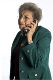 Business woman with attitude. Senior business woman pretty aggravated on phone stock photography