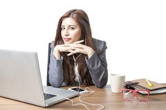 Business woman attractive enjoy with listening music on the desk. Business woman attractive beautiful   sitting at office desk and enjoy with listening music Stock Photography