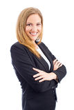 Business woman. Attractive business woman wearing a suit with arms crossed royalty free stock photography
