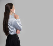 Business woman from the back looking at something Stock Photos