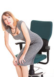 Business woman with back pain after long work on chair Isolated Stock Photography