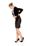 Business woman with back problems and stomach ache Royalty Free Stock Photography