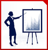 Business woman on background with financial charts Stock Photo
