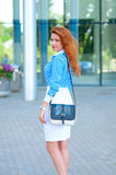 Business woman with bag in front of office building Royalty Free Stock Photography