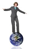 Business woman balancing on earth Royalty Free Stock Images