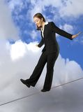 Business woman balancing on rope Stock Images