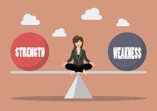Business woman balancing between strength and weakness Royalty Free Stock Photography