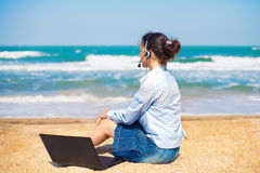 Business woman on the beach Stock Photography