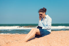 Business woman on the beach Royalty Free Stock Photos