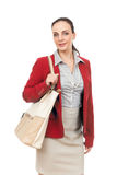 Business woman with a beige handbag Royalty Free Stock Image