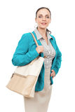 Business woman with a beige handbag Royalty Free Stock Photos