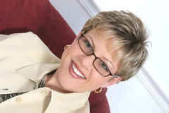 Business Woman in Beige Wearing Glasses Royalty Free Stock Photography