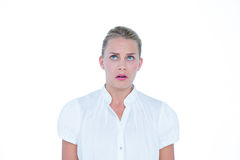 Business woman being anxious. Against a white wall Stock Image