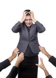 Life pulling you down. Business woman being pulled down by hands all around her Stock Image