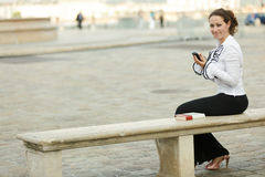 Business woman on bench Royalty Free Stock Photo