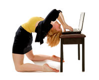 Business Woman Bending Over Backwards. A business woman bending backwards over laptop stock image