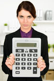 Business woman with big calculator Stock Photos