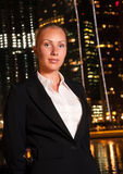 Business woman in the big city at night. Young business woman in the big city at night Royalty Free Stock Photography