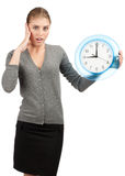 Business woman with big clock. Surprised business woman holding a big clock, over white background stock images