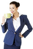 Business woman with big mug Stock Photography