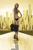 Business woman in bikini golden city on back Stock Photography