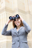 Business Woman with Binoculars. A pretty business woman looking through binoculars Stock Photography