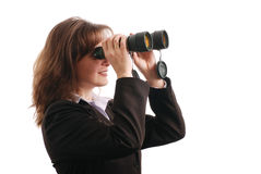 Business woman with binoculars - isolated Royalty Free Stock Images
