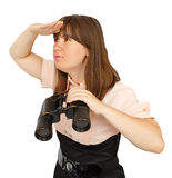 Business woman with binoculars looking into the distance Stock Images