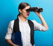 Business woman with a binoculars Stock Images