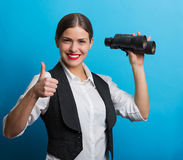 Business woman with a binoculars Stock Photography