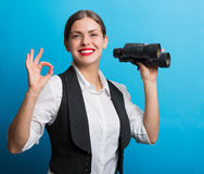 Business woman with a binoculars. Pretty woman holding binoculars. Searching for new opportunities business concept Royalty Free Stock Images