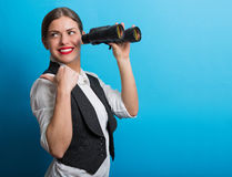 Business woman with a binoculars. Pretty woman holding binoculars. Searching for new opportunities business concept Royalty Free Stock Photo
