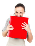 Business woman bites in a red binder Stock Photos