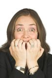Business woman biting her nails Royalty Free Stock Photography
