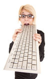Business woman biting keyboard Stock Image