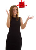 Business woman in a black dress catches a gift Stock Photos