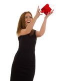Business woman in a black dress catches a gift Royalty Free Stock Images