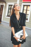 Business woman in black dress in the city with documents Stock Image