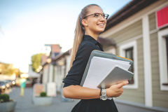 Business woman in black dress in the city with documents Stock Images