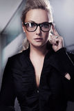 Business woman in black glasses Royalty Free Stock Images