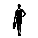 Business woman black silhouette hold briefcase. Standing full length over white background Stock Photo