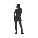 Business Woman Black Silhouette. Woman in Short Dress or Skirt. Black Silhouette Standing Full Length Over White Background. Vector Illustration. Front View Royalty Free Stock Image