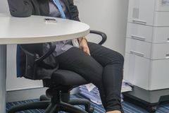 Business woman in black trousers sit on the chair in meeting room. Close up business woman in black trousers sit on the chair in meeting room stock photos