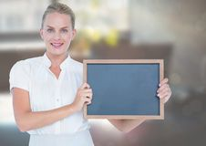 Business woman with blackboard in the office. Stock Photos
