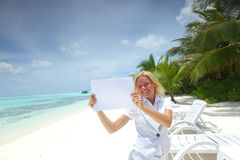 Business woman with blank paper on the ocean coast Stock Photos
