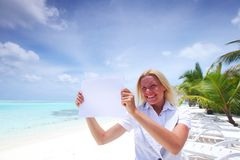 Business woman with blank paper on the ocean coast Stock Photography