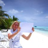 Business woman with blank paper on the ocean coast Royalty Free Stock Photo