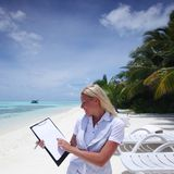 Business woman with blank paper on the ocean coast Royalty Free Stock Photos